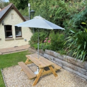 Schoolhouse garden with BBQ and seating